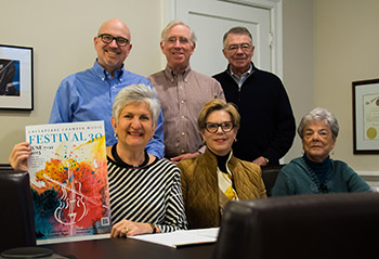 Pictured is Chesapeake Chamber Music Festival Committee showcasing this year's Festival 30 poster, created by graphic designer Joanne Shipley. The 30th Annual Chesapeake Chamber Music (CCM) Festival will be held in Easton, MD from June 7 through June 21, 2015. Pictured front row, left to right are Festival chairperson Bernice Michael and committee members Carolyn Rugg, Mary Riedlin. Pictured back row are Don Buxton, director of CCM; Mike Bracy, president of CCM, and Bill Geoghegan, Director of Communications.