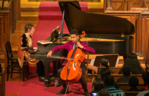 "Pictured is Lev Mamuya, a nineteen-year old cellist attending a dual degree program at the New England Conservatory of Music and Harvard University, whose musical composition ""loosely turing"" will have its world premiere at the Chesapeake Chamber Music Competition on June 11 at 4 p.m. at the Academy Art Museum."